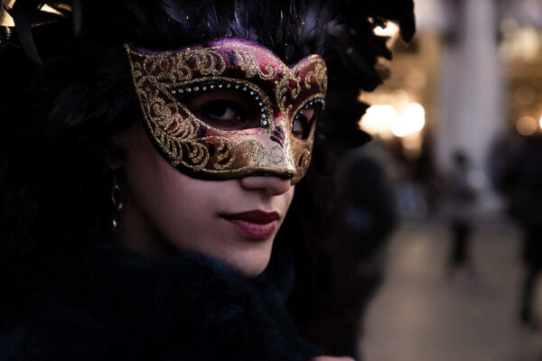 Girl in Venice with Fully Feathered Colombina Mask