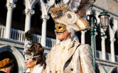 Why do Venetians wear masks during the carnival?